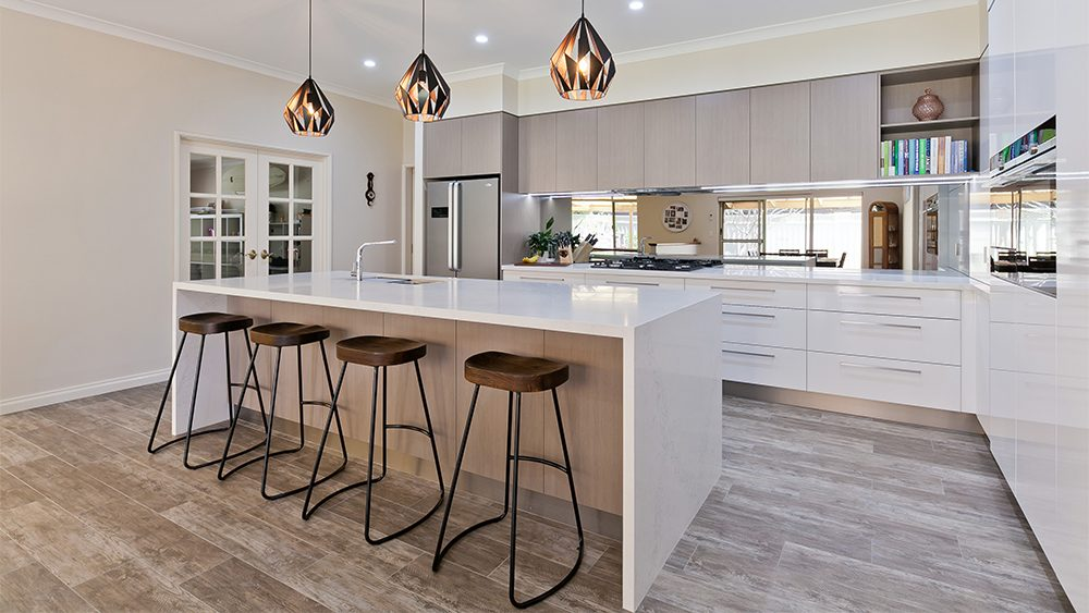 large open custom kitchen design perth featuring designer pendant lights and mirrored splashbacks