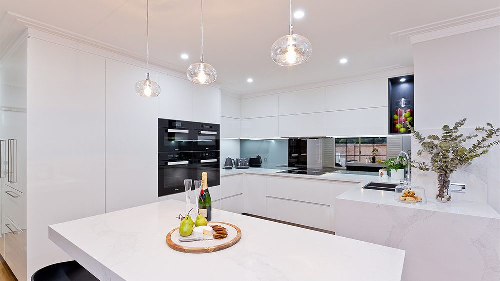 refurbished kitchen by salt with pendant lighting and marble benches