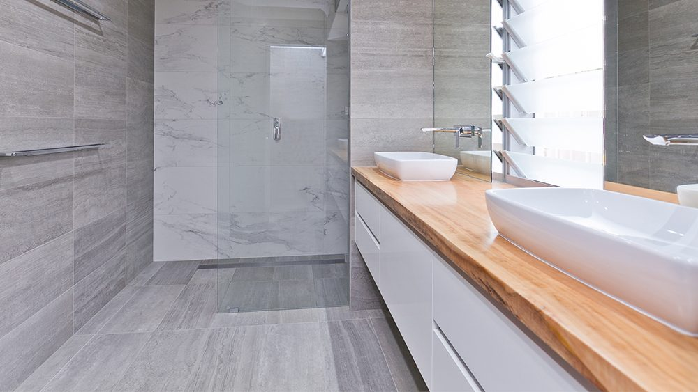perth bathroom renovation with cabinetry, wooden surfaces, and custom tiling