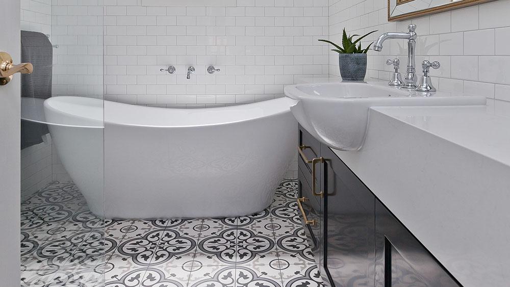 salt luxury bathroon design with custom tiling and freestanding bath