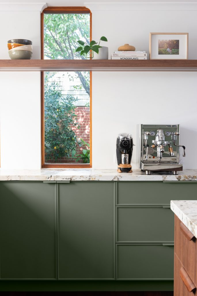 close up photo of kitchen cabinets with large windows behind them