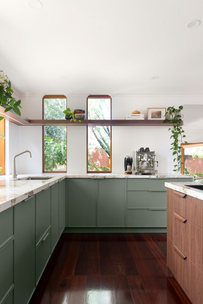 Beautiful kitchen with a matt forrest green finish