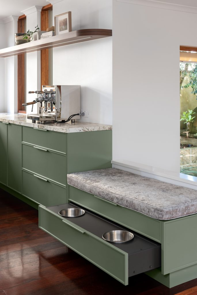 bespoke cabinets opened up to reveal two dog bowls