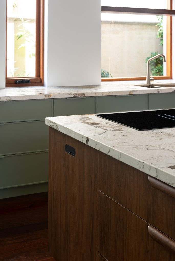 wooden kitchen cupboard doors under a marble benchtop