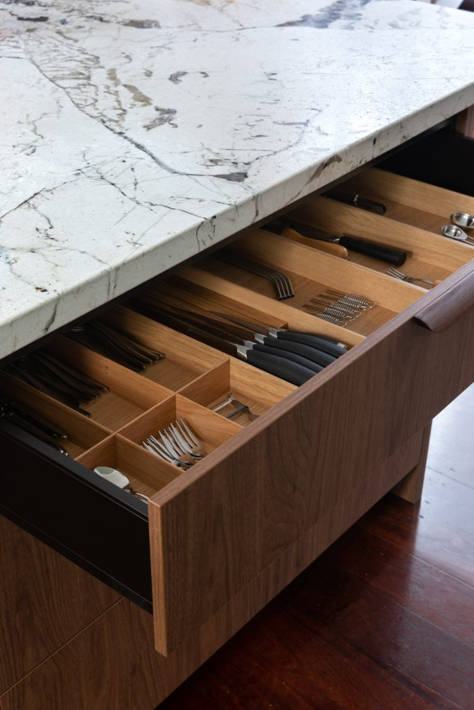 marble kitchen bench with a custom made wooden cutlery drawer