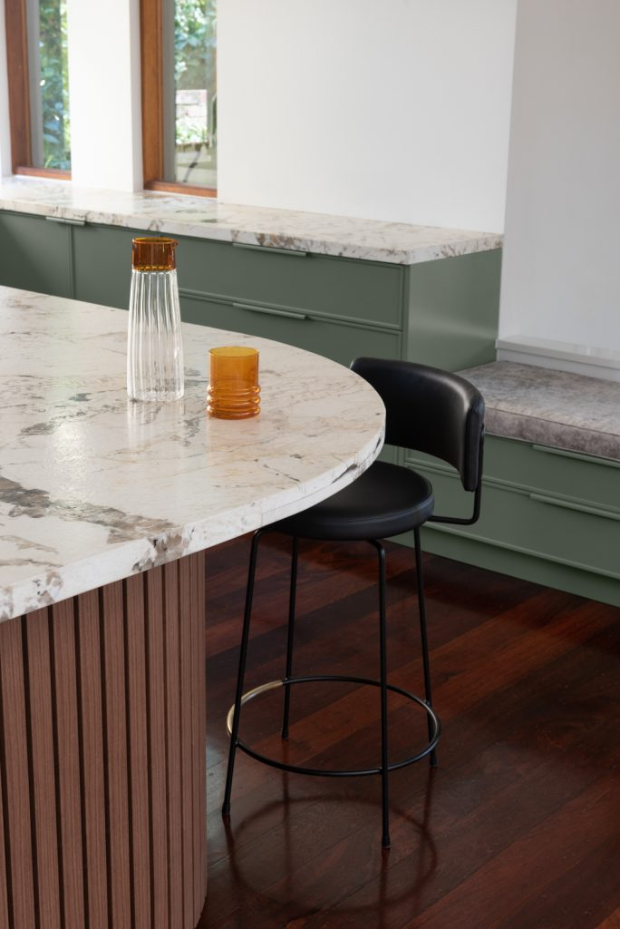 marble kitchen benchtop with designer stool